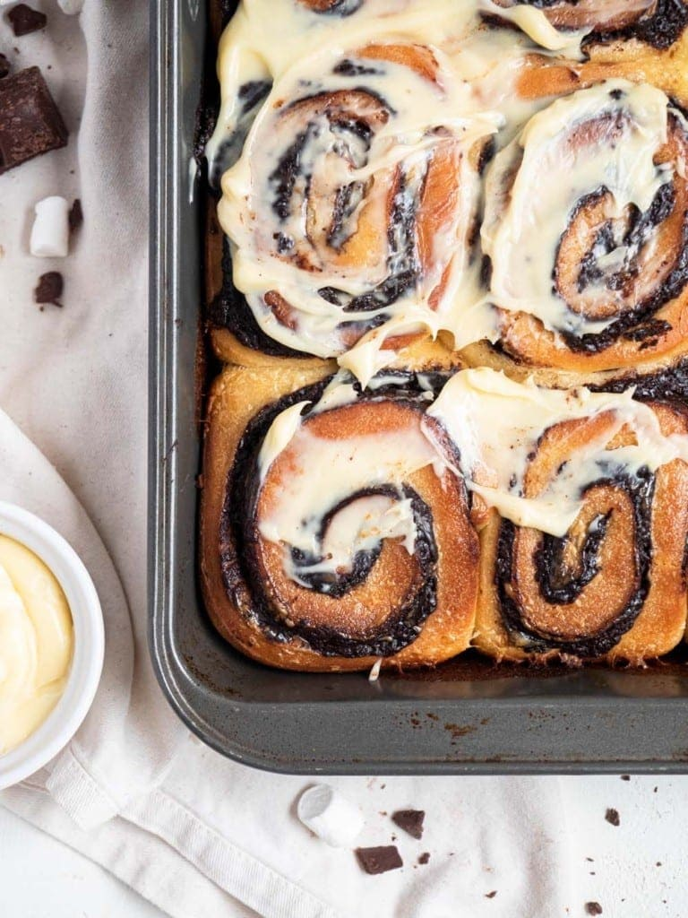 Hot chocolate rolls with marshmallow cream cheese frosting
