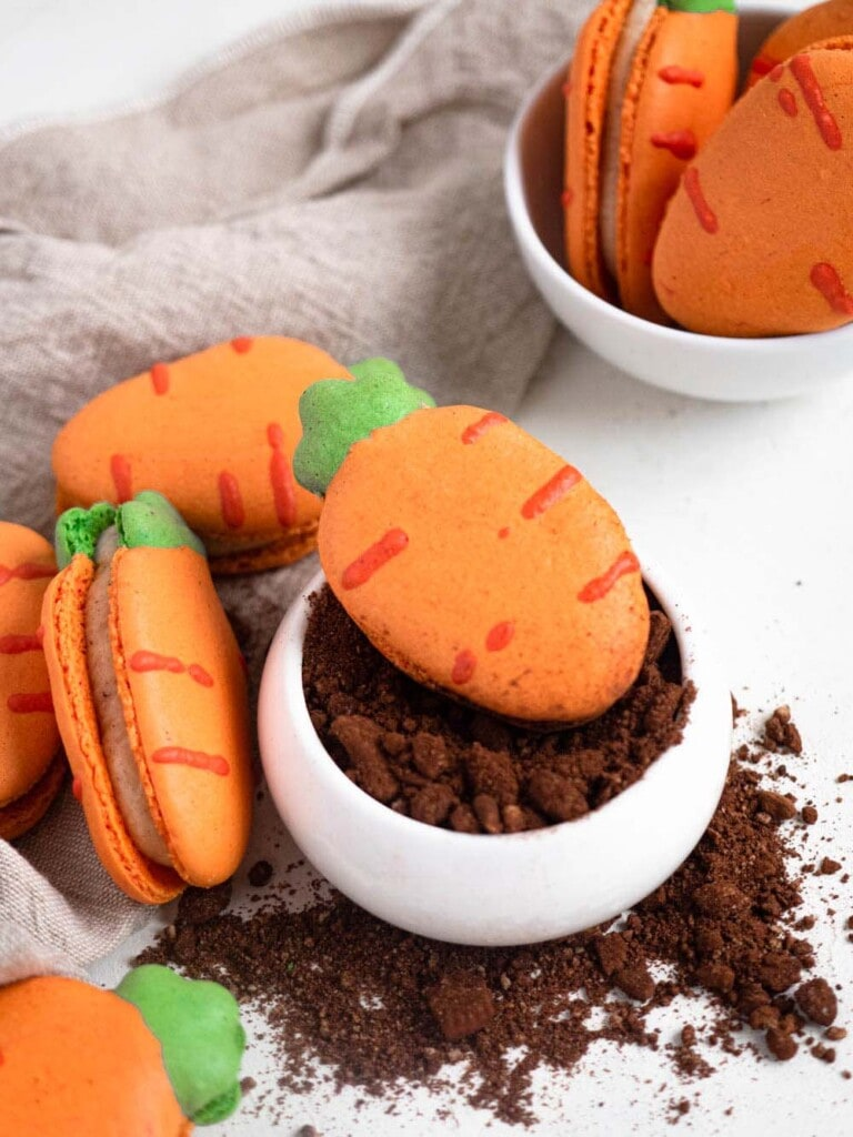 Carrot shaped macarons filled with carrot cake cream cheese buttercream easter cookies