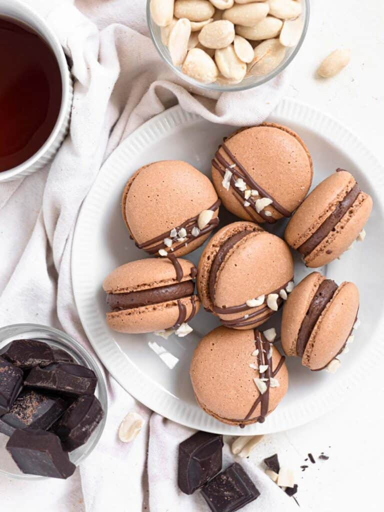 Macarons filled with silky chocolate buttercream and crunchy peanut butter