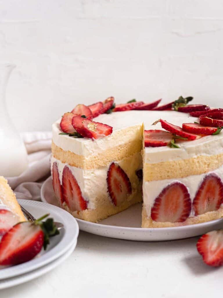 Frasier cake with strawberries, pastry cream and whipped cream in a soft and fluffy sponge cake