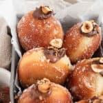 Fluffy yeast raised donuts filled with Nutella chocolate hazelnut whipped cream bombolini