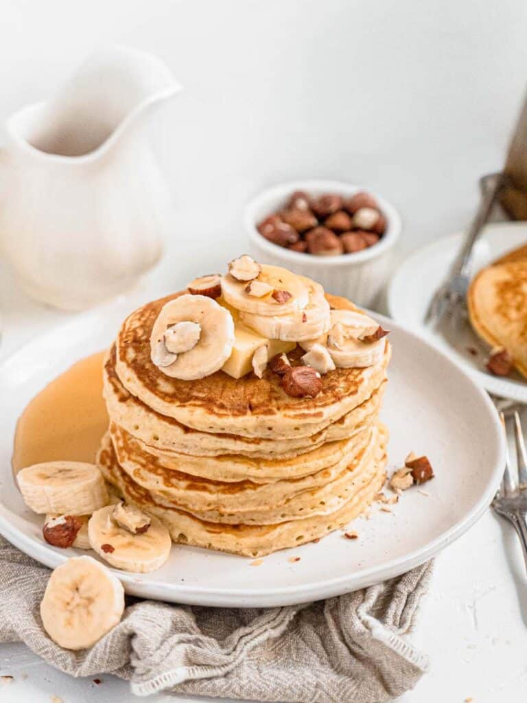 Easy soft and fluffy pancakes with banana and maple syrup