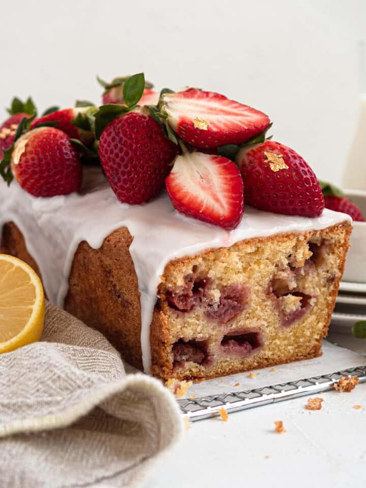 Moist strawberry pound cake with lemon glaze and fresh strawberries