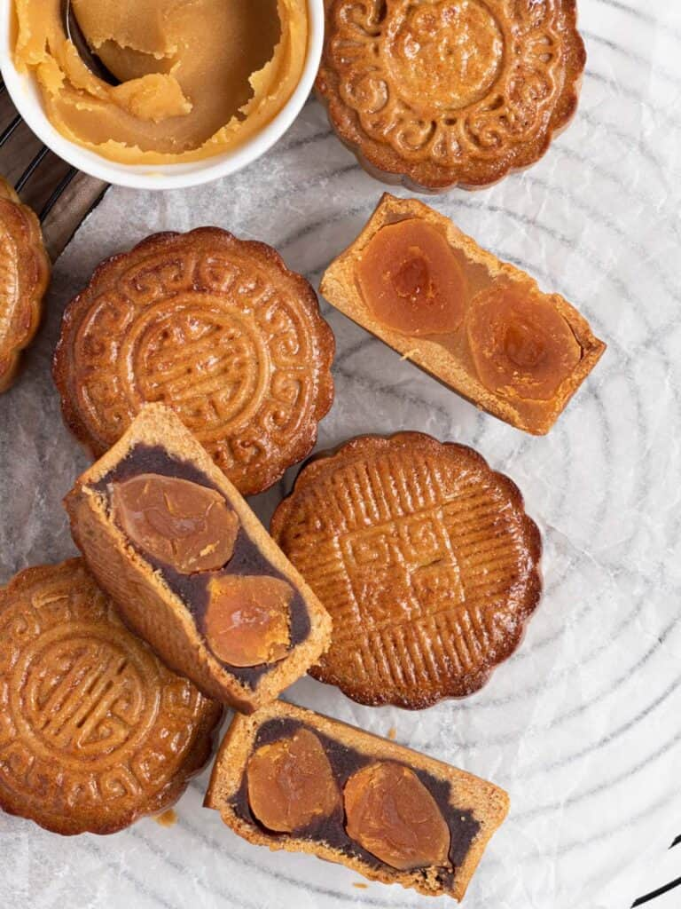 Traditional cantonese style baked mooncakes with chestnut and red bean paste and double salted duck yolks