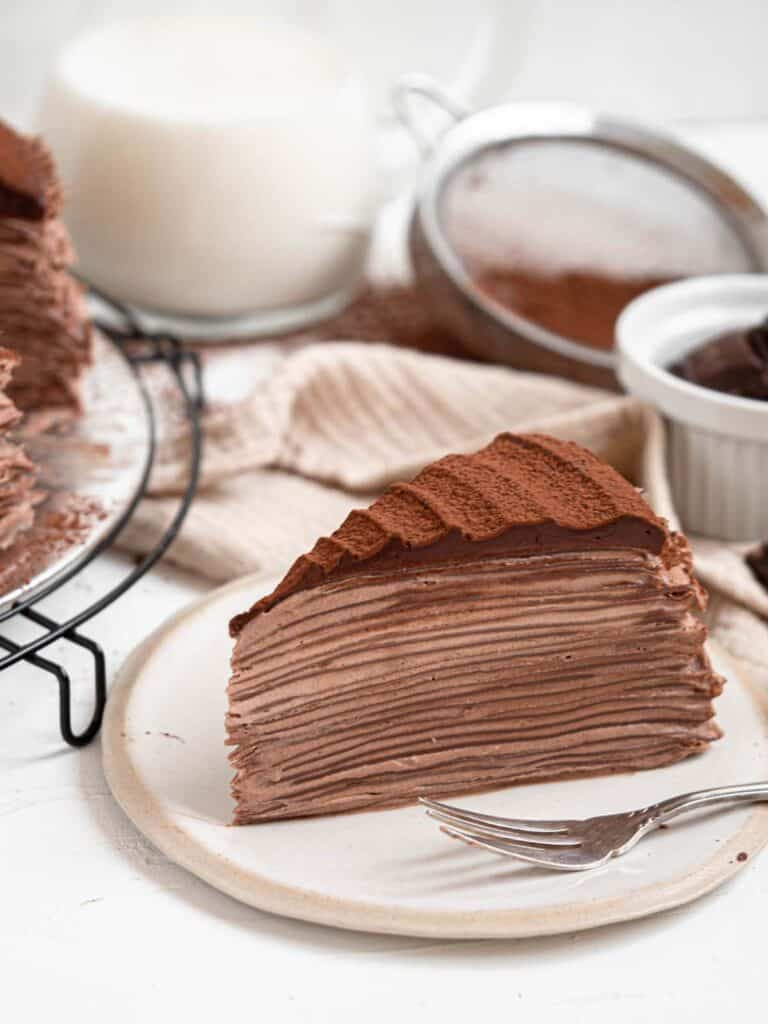 Chocolate mille crepe cake with chocolate whipped cream and ganache