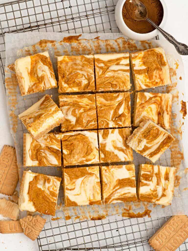 Creamy pumpkin spice swirl cheesecake bars
